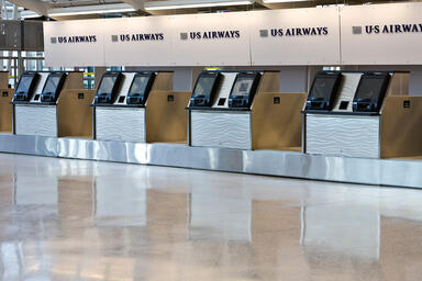 Ticket counter panels in Stainless Steel with Sandstone finish and Chardonnay
