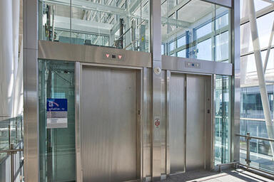 Elevator doors in Stainless Steel with Sandstone finish and Dallas pattern