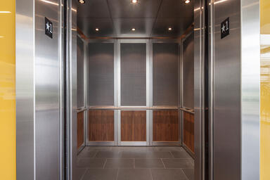 LEVELc-2000N Elevator Interior with upper panels in Bonded Aluminum