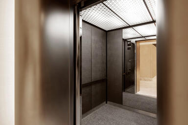 LEVELe-105 Elevator Interior with customized panel layout; Minimal panels in Sta