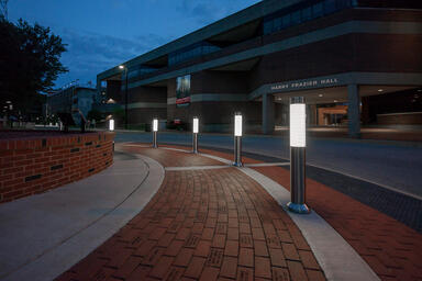 Light Column Bollards in Stainless Steel with Satin finish shown in illuminated