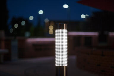 Light Column Bollard in Stainless Steel with Satin finish shown in illuminated