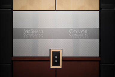 Wall panels shown in Stainless Steel with Satin finish and custom Eco-Etch