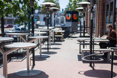 Bistro Tables shown with Diamond Stainless Steel table tops