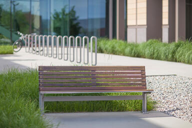 Knight Bench shown in 6 foot, backed configuration, Aluminum Texture