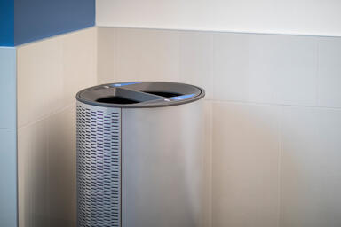 Orbit Litter & Recycling Receptacle shown in split-stream configuration