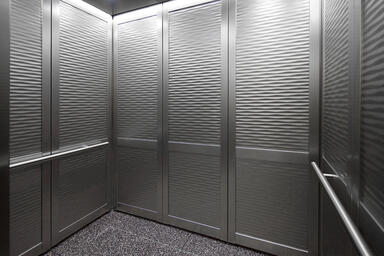 LEVELc-2000N Elevator Interior with inset panels in Stainless Steel with Seas