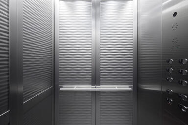 LEVELc-2000N Elevator Interior with inset panels in Stainless Steel