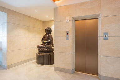 Elevator doors in Fused Nickel Bronze with Seastone finish at Prime Beach Reside