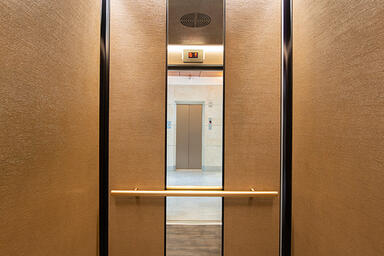 LEVELe-105 Elevator Interior with customized panel layout; Minimal panels in Bon