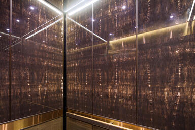 LEVELe-105 Elevator Interior with Capture panels in ViviStone Honey Onyx