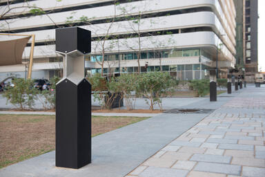 Knight Bollards shown with Black Texture powdercoat at a pocket park, Abu Dhabi