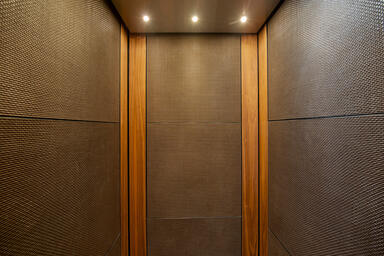 LEVELe-102 Elevator Interior with customized panel layout; panels in Bonded Bron