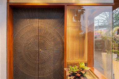 Doors shown in Bonded Bronze with Dark Patina and Solstice pattern at Private Re