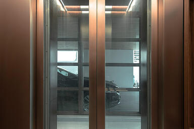 Elevator doors in Fused White Gold with Seastone finish at Private Residence, T.
