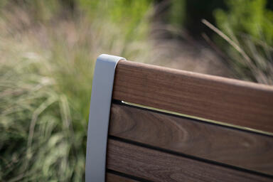 Detail of Trio Bench shown in backed configuration with Aluminum Texture