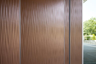 LEVELe Wall Cladding System with Capture panels, insets in Bonded Bronze