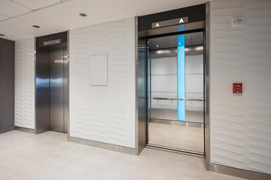 LEVELe-107 Elevator Interior with Capture panels in ViviChrome Chromis glass