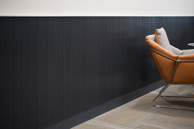 Wall panels in Bonded Quartz, Charcoal, with Loft pattern