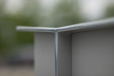 Detail of Knight Litter Receptacle shown with Aluminum Texture powdercoat