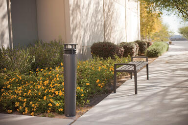 Cordia Bollard shown with Slate Texture powdercoat; Cordia Bench also shown