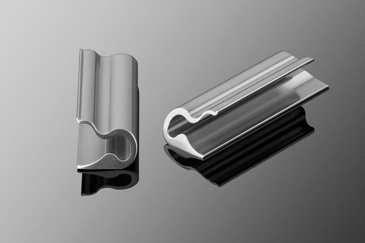 Wave model WAC1833-04 cabinet pulls shown in Clear Polished Anodized Aluminum (3