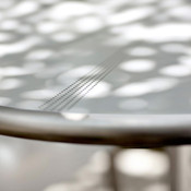 Citrus Table shown with Satin Stainless Steel, perforated table top with center