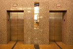 Stainless Steel Elevator Doors in Seastone Finish with Champagne pattern