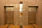Elevator Doors in Stainless Steel with Seastone finish and Champagne Impression